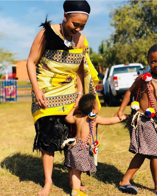 Woman And Kids Dressed In Swati Traditional Attire For