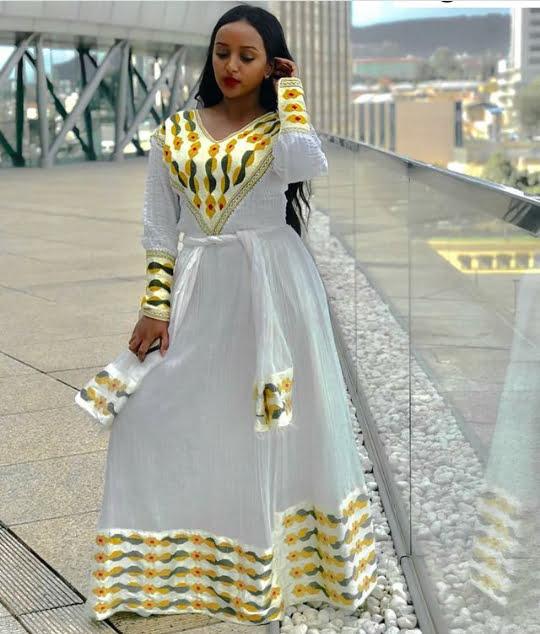 b5ec78106c Ethiopian Lady In Habesha Kemis Traditional Attire