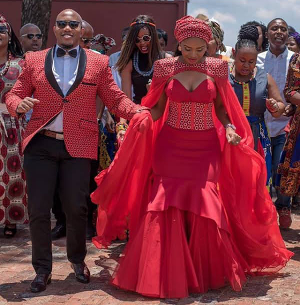 Couple In Beautiful Red Shweshwe Traditional Wedding
