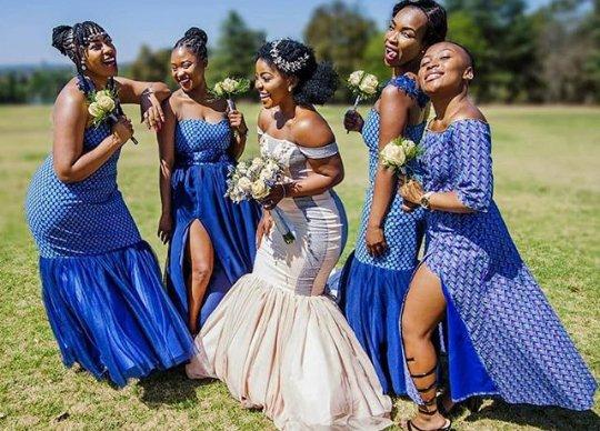 b4fd675d9df Bride In Off Shoulder Wedding Dress With Maids In Shweshwe Dresses ...
