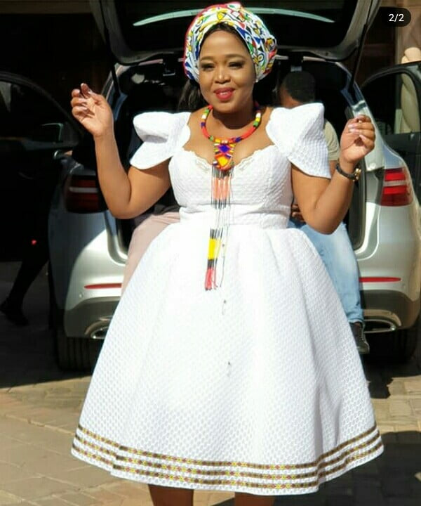 Winnie Mashaba Outfits: Winnie Mashaba In Cap Sleeves White Dress With Ndebele