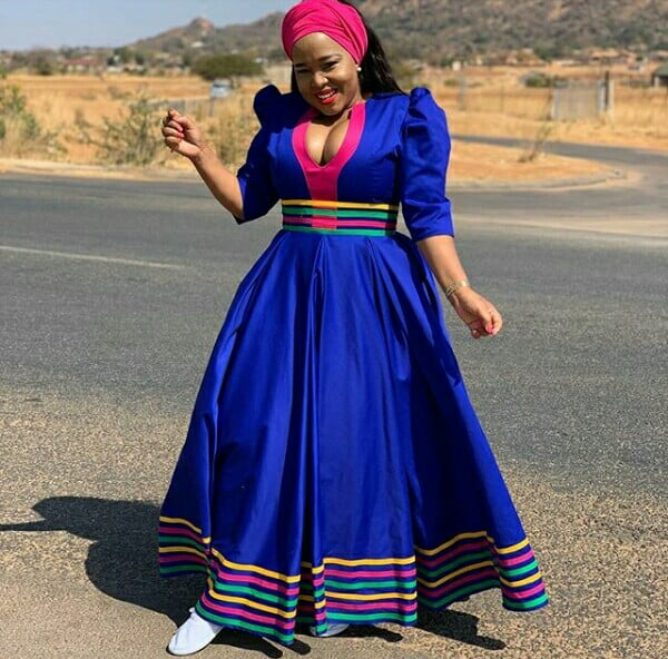 Winnie Mashaba Outfits: Winnie Mashaba In Blue Patterned Sepedi Flared Dress With