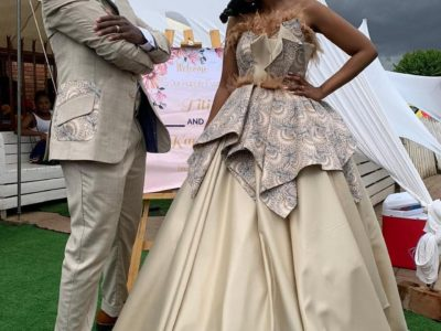 Groom's Suit and Bride's Gown with Brown Shweshwe Details